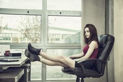 Tired bored young female office worker Royalty Free Stock Photos