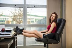 Tired bored young female office worker Stock Photography