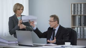 Tired boss angry at assistant, corporate ethics, inappropriate work behavior. Stock footage stock footage