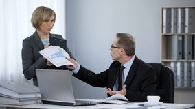 Tired boss angry at assistant, corporate ethics, inappropriate work behavior. Stock photo royalty free stock photo