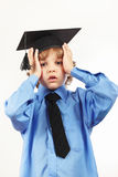 Tired boy in academic hat on white background Stock Images