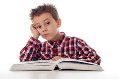 Tired boy with book Royalty Free Stock Photo