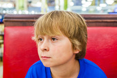 Tired boy in a diners Royalty Free Stock Images