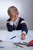 Tired boy during doing homework Royalty Free Stock Photo