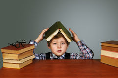 A tired boy . Heavy homework Stock Photo
