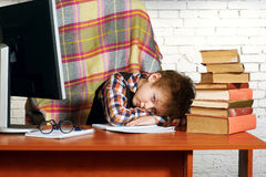 A tired boy . Heavy homework Royalty Free Stock Image