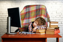 A tired boy . Heavy homework Stock Photography