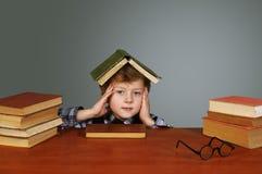 A tired boy . Heavy homework Stock Image