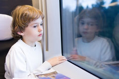 Tired boy in a high speed train Royalty Free Stock Photo