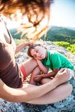 The tired boy lies on his mother`s feet royalty free stock photos
