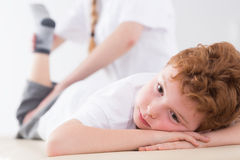 Tired boy during physiotherapy Royalty Free Stock Photos