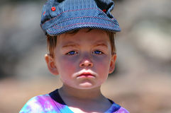 Tired boy portrait. Portrait of a young boy, he looks tired and sad Royalty Free Stock Images