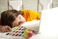 Tired boy sleeping on a lesson royalty free stock photos