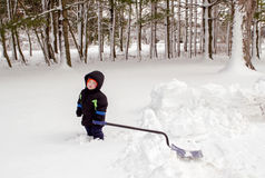Tired boy trying to shovel snow Stock Photography
