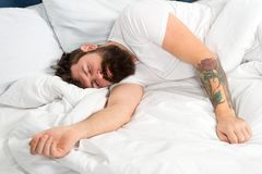 So tired. brutal sleepy man in bedroom. mature male with beard in pajama on bed. energy and tiredness. asleep and awake. Bearded man hipster sleep in morning royalty free stock image