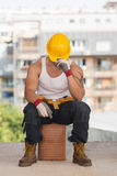 Tired Builder Resting On Brick Royalty Free Stock Image