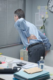 Tired business with back pain Stock Image