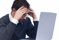 Tired business man at laptop Royalty Free Stock Image