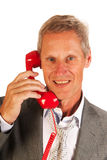 Tired business man at the phone Royalty Free Stock Photos