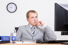 Tired business man sitting at work Royalty Free Stock Images