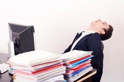 Tired business man sleeping at work. Stock Photos
