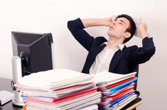 Tired business man sleeping at work. Royalty Free Stock Images