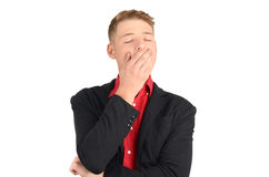 Tired business man yawning. Stock Image