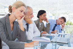 Tired business team at conference Royalty Free Stock Image