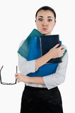 Tired business woman with folders and glasses for vision in her Stock Photography