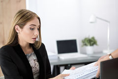 Tired business woman getting new heap of documents Royalty Free Stock Photography