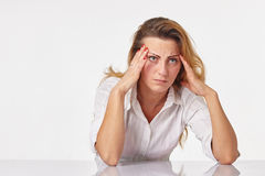 Tired business woman having a headache. A Tired business woman having a headache Royalty Free Stock Photo