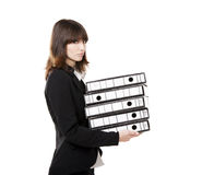 Tired business woman holding folders Stock Photo