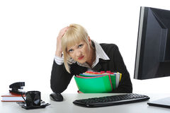 Tired business woman in the office. Royalty Free Stock Photography