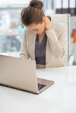 Tired business woman in office Stock Image