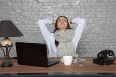 Tired business woman is resting in the office. Portrait of a business person Royalty Free Stock Photos