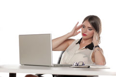 Tired business woman. Sitting at her desk with a laptop and having a headache Stock Photography
