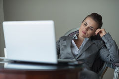 Tired business woman sitting in hotel room Royalty Free Stock Photos