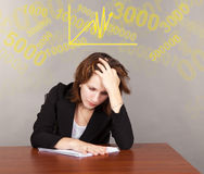Tired business woman sitting at the table Royalty Free Stock Images