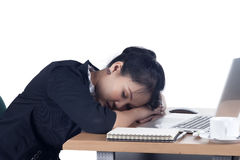 Tired business woman sleeping at her desk. Royalty Free Stock Photo