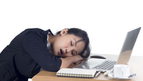 Tired business woman sleeping at her desk Stock Images