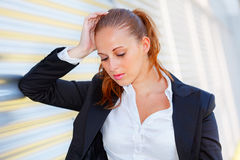Tired business woman standing at office building Royalty Free Stock Photography