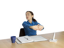 Tired business woman stretching Royalty Free Stock Images