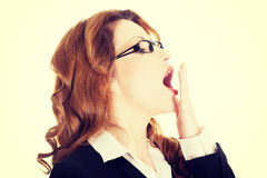 Tired business woman in a suit Royalty Free Stock Image