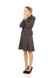 Tired business woman in a suit. Stock Images