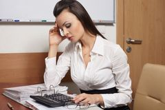 Tired business woman thinking about something Royalty Free Stock Photo