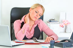 Tired business woman working with documents Royalty Free Stock Image