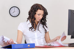 Tired business woman working with documents Royalty Free Stock Photo