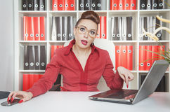 Tired business woman working with laptop Stock Photography
