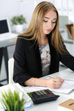 Tired business woman working at the office Royalty Free Stock Image