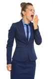 Tired business woman yawning Royalty Free Stock Image